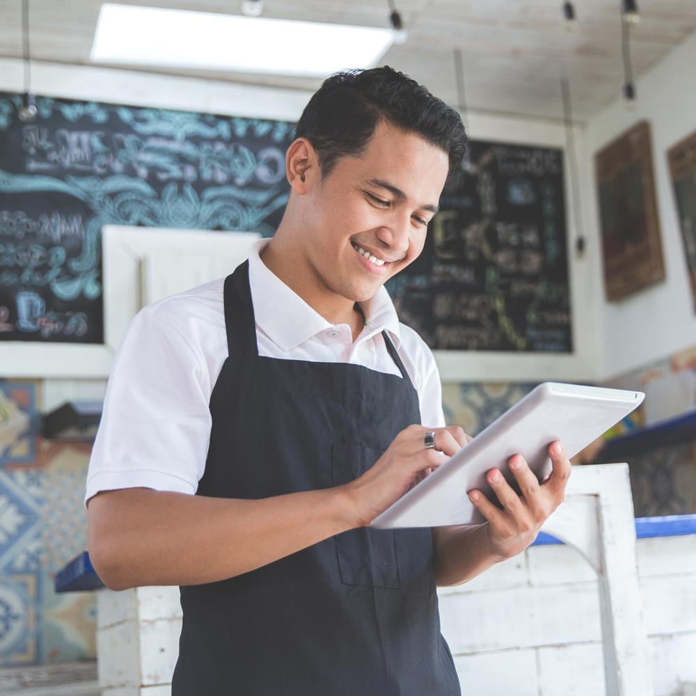 Business owner on tablet